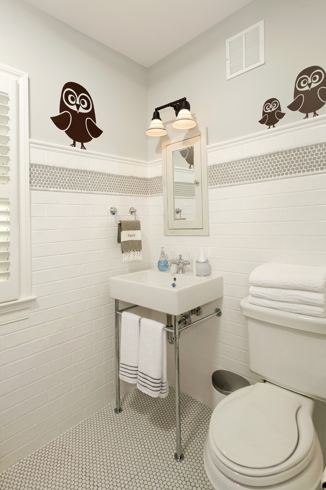 Example of a classic kids' white tile and subway tile bathroom design in DC Metro with a console sink and a two-piece toilet