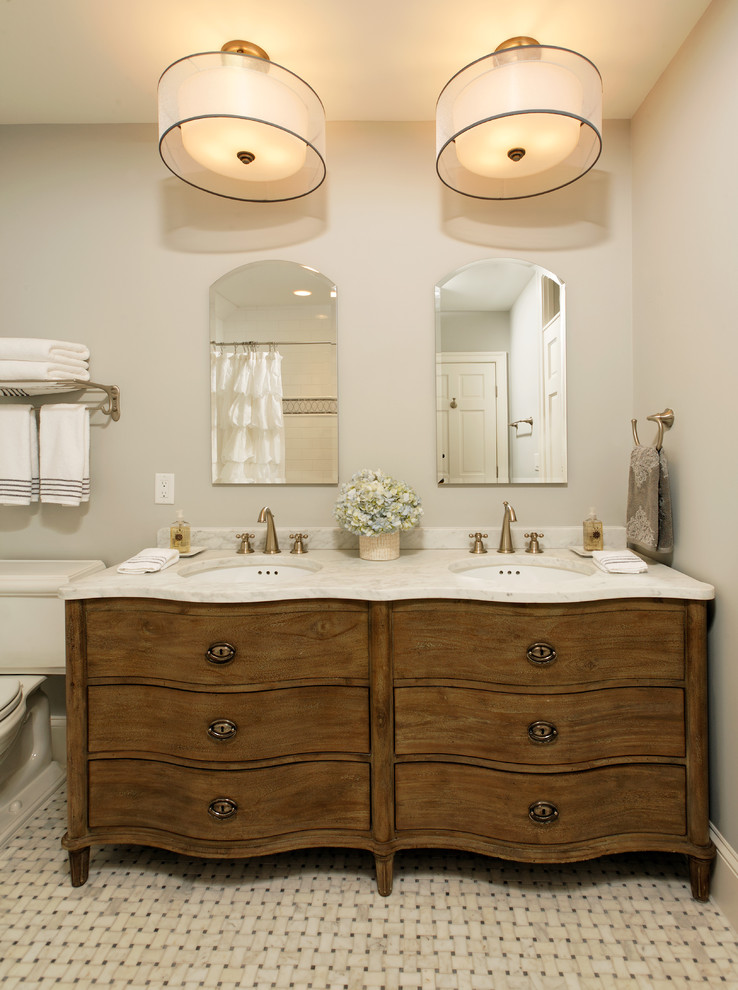 Elegant bathroom photo in DC Metro with furniture-like cabinets
