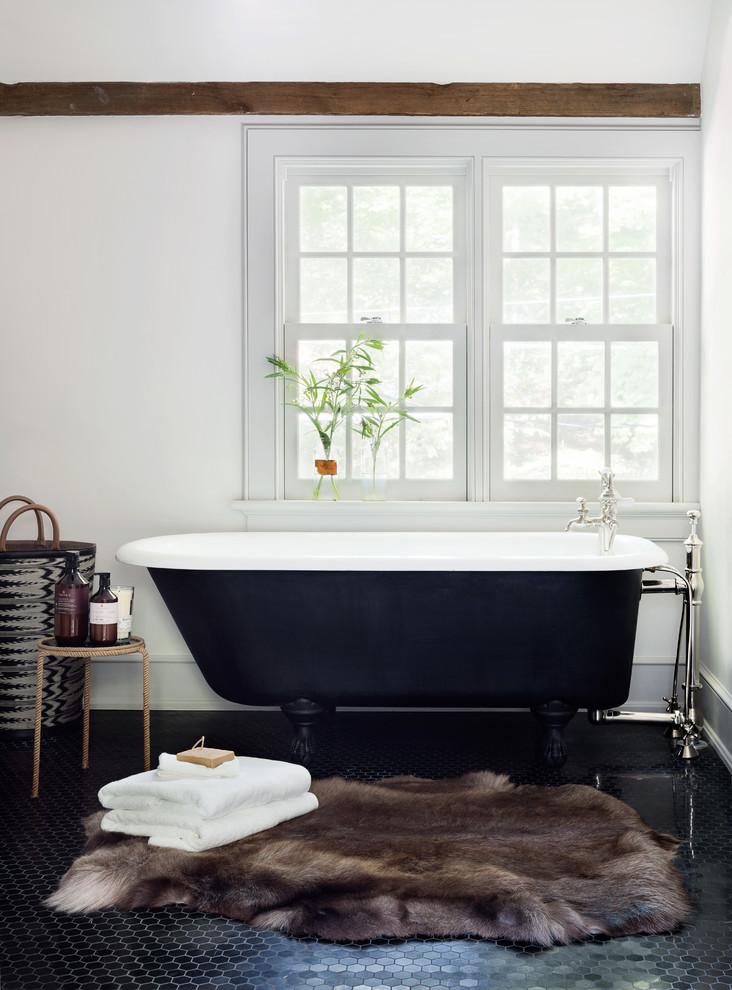 Claw-foot bathtub - traditional master claw-foot bathtub idea in New York with white walls