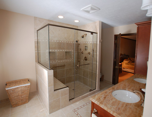 What are the dimensions of the shower area and is the seat and shower pan one piece?