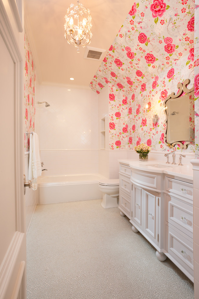 Elegant white tile bathroom photo in Minneapolis with an undermount sink, white cabinets and recessed-panel cabinets