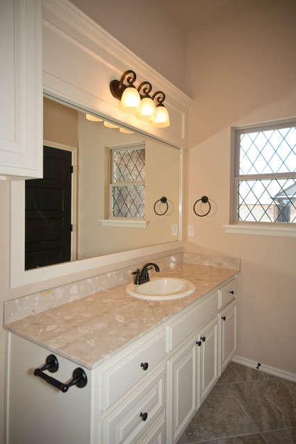 Traditional bathroom with white cabinets and dark hardware for Bathroom cabinets okc