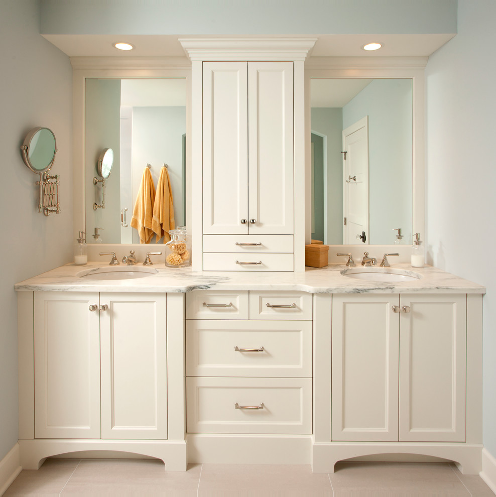 Elegant bathroom photo in Minneapolis with an undermount sink, recessed-panel cabinets and white cabinets