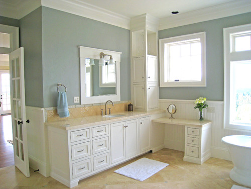 Lovely bathroom! Do you feel the wainscoting, vanity and trim should be the same color or very ...
