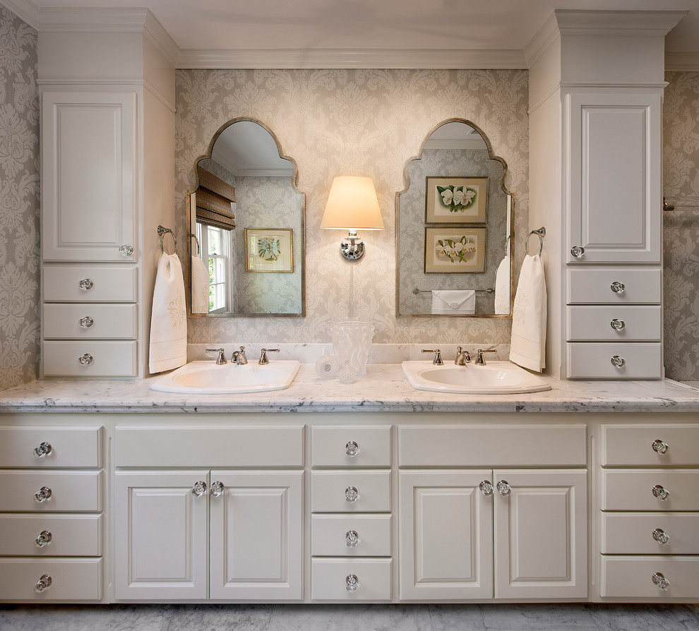 Bathroom - traditional bathroom idea in Santa Barbara with a drop-in sink, raised-panel cabinets and white cabinets
