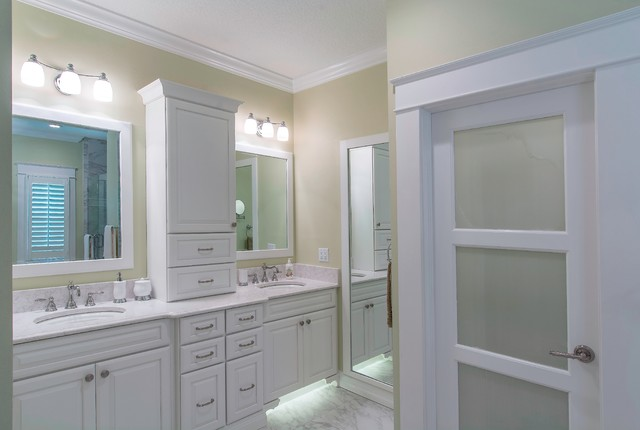 Example of a classic master gray tile and porcelain tile porcelain floor bathroom design in Tampa with an undermount sink, raised-panel cabinets, white cabinets, engineered quartz countertops, a wall-mount toilet and green walls