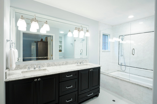 Traditional master bathroom with dark cabinets and white Quartz countertop