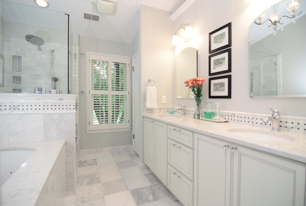 Example of a classic multicolored tile doorless shower design in DC Metro with an undermount sink, recessed-panel cabinets, white cabinets, engineered quartz countertops and an undermount tub