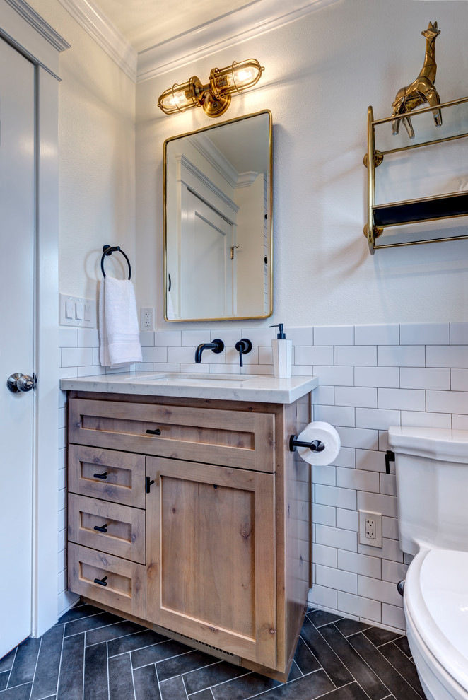 Example of a small country kids' white tile and porcelain tile porcelain tile and black floor bathroom design in San Francisco with shaker cabinets, medium tone wood cabinets, a two-piece toilet, white walls, an undermount sink, quartz countertops and white countertops