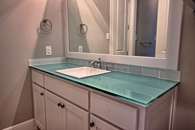 Bathroom - mid-sized transitional 3/4 blue tile and glass tile bathroom idea in Dallas with shaker cabinets, white cabinets, gray walls, a drop-in sink and glass countertops