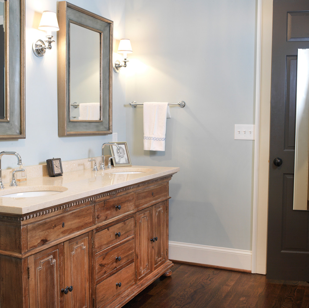 Example of a transitional bathroom design in Atlanta with furniture-like cabinets