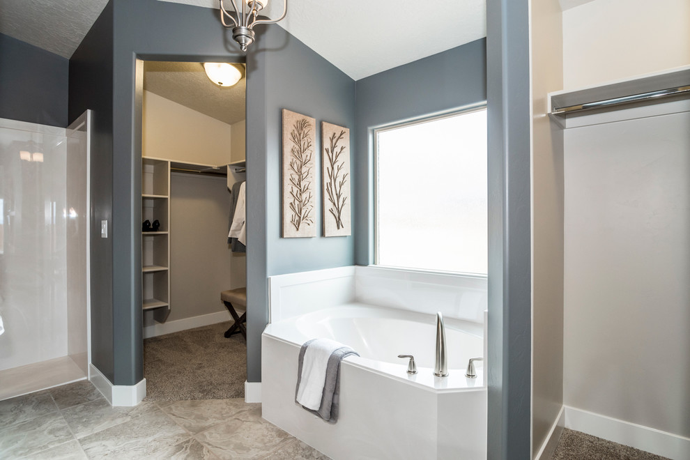 Inspiration for a mid-sized transitional master beige tile and porcelain tile ceramic tile and beige floor bathroom remodel in Salt Lake City with dark wood cabinets, a two-piece toilet, an integrated sink, gray walls, shaker cabinets and solid surface countertops