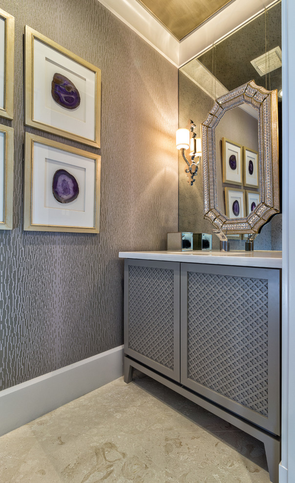 Example of a transitional bathroom design in Miami with gray cabinets