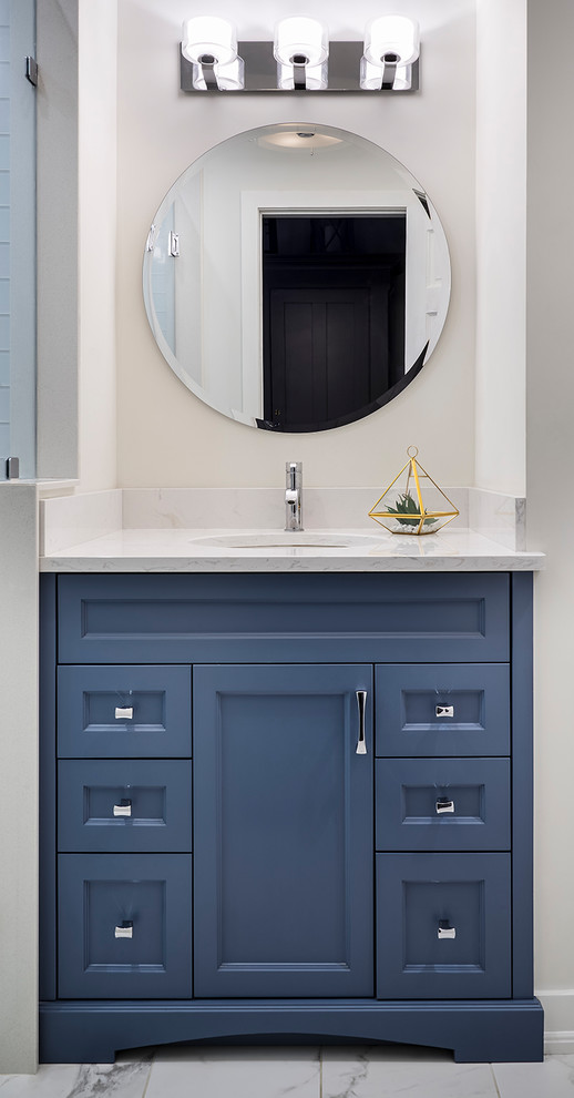 Doorless shower - small transitional kids' white tile and porcelain tile porcelain tile and white floor doorless shower idea in Toronto with furniture-like cabinets, blue cabinets, a one-piece toilet, white walls, an undermount sink, quartz countertops and a hinged shower door
