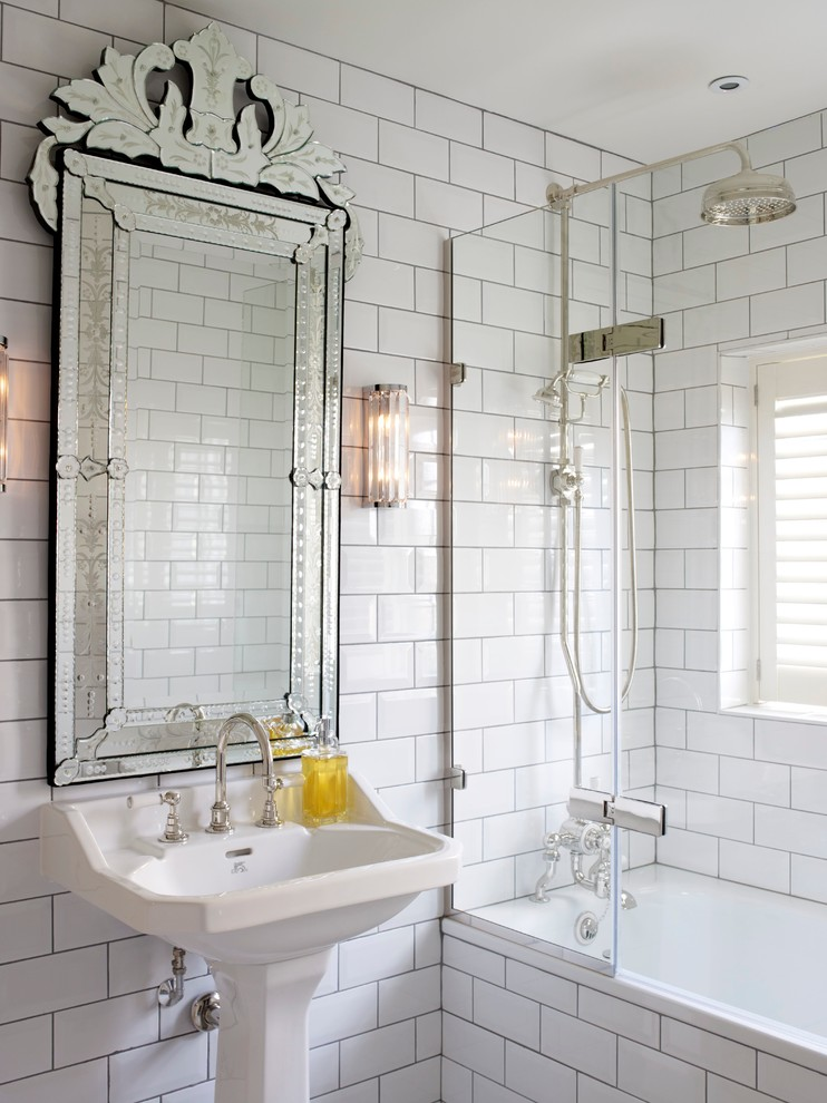 Inspiration for a transitional white tile and subway tile tub/shower combo remodel in London with a pedestal sink and white walls