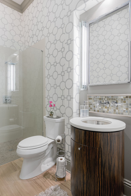 This is an example of a medium sized traditional ensuite bathroom in Tampa with flat-panel cabinets, dark wood cabinets, a built-in shower, a two-piece toilet, grey tiles, white tiles, multi-coloured walls, light hardwood flooring, a submerged sink, porcelain tiles, solid surface worktops, beige floors and a hinged door.