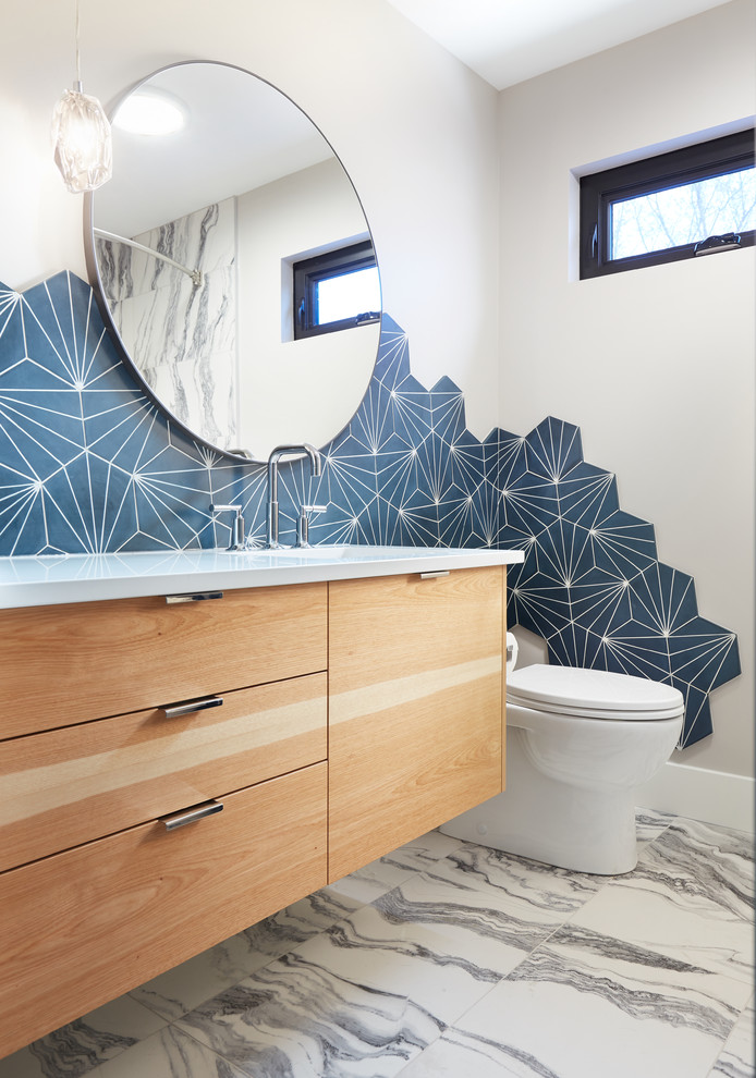 Example of a small transitional 3/4 gray tile and cement tile ceramic tile and white floor bathroom design in Edmonton with flat-panel cabinets, light wood cabinets, a one-piece toilet, an undermount sink, quartz countertops and beige walls