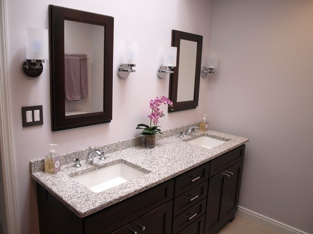 Bathroom - large transitional master beige tile and ceramic tile porcelain floor and beige floor bathroom idea in Newark with flat-panel cabinets, brown cabinets, a two-piece toilet, beige walls, an undermount sink and granite countertops
