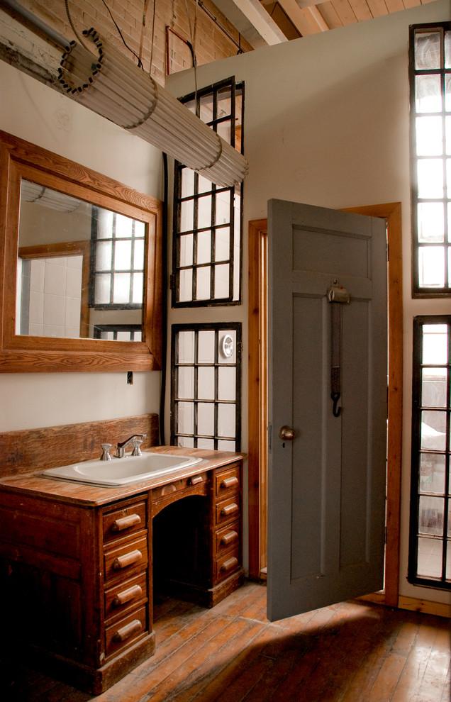 Bathroom - rustic bathroom idea in Toronto with wood countertops