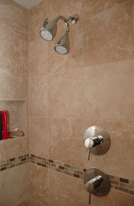 Travertine shower and stainless fixtures - contemporary - bathroom