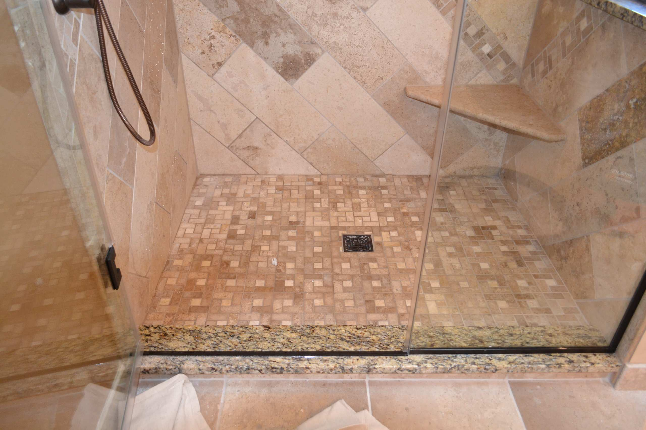 Travertine Shower with glass enclosure