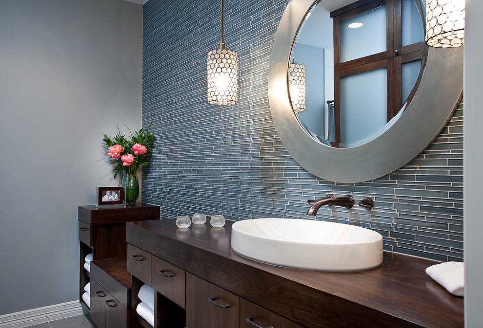 Trendy blue tile and matchstick tile bathroom photo in Austin with a vessel sink, flat-panel cabinets, dark wood cabinets and wood countertops
