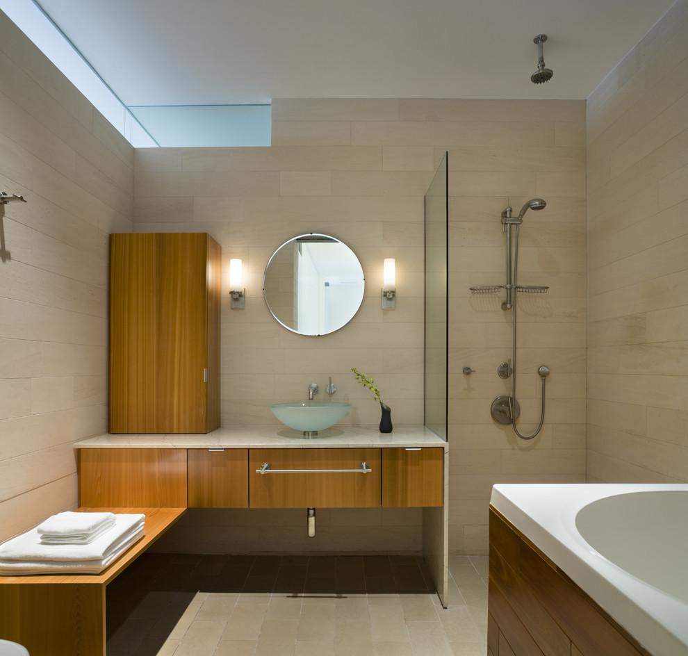 Bathroom - modern stone tile bathroom idea in New York with a vessel sink
