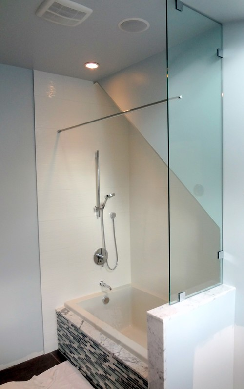 Where can find shower curtain rod to attach to glass panel?