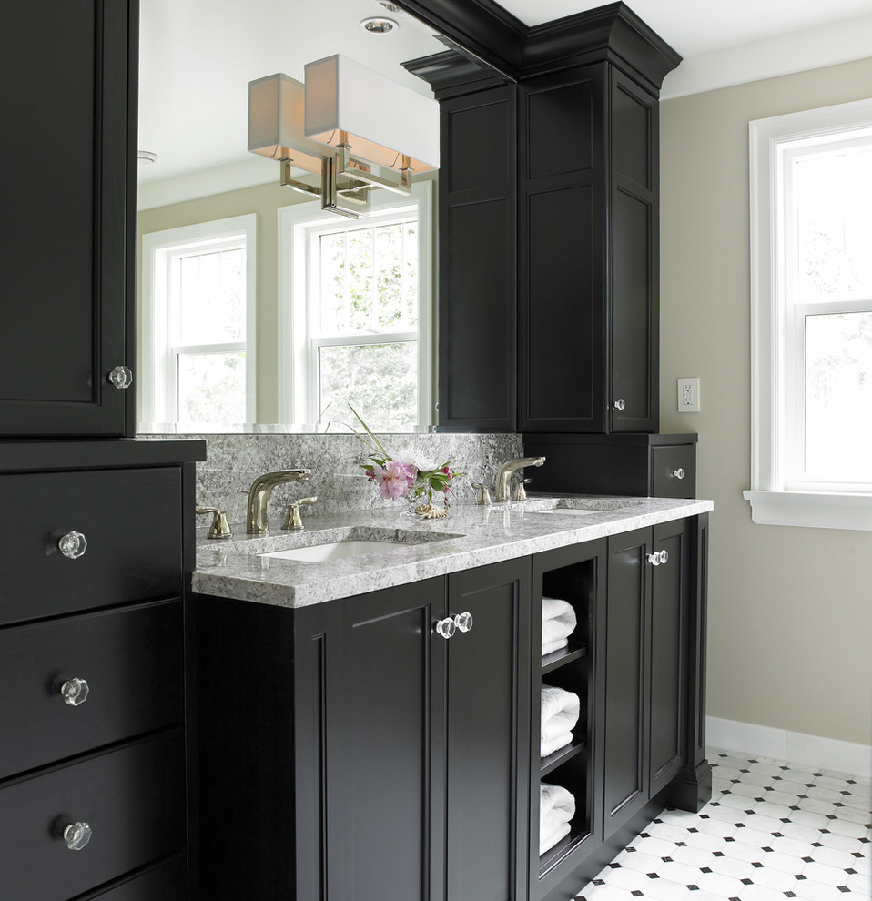 Transitional white tile bathroom photo in Vancouver with an undermount sink, recessed-panel cabinets and black cabinets