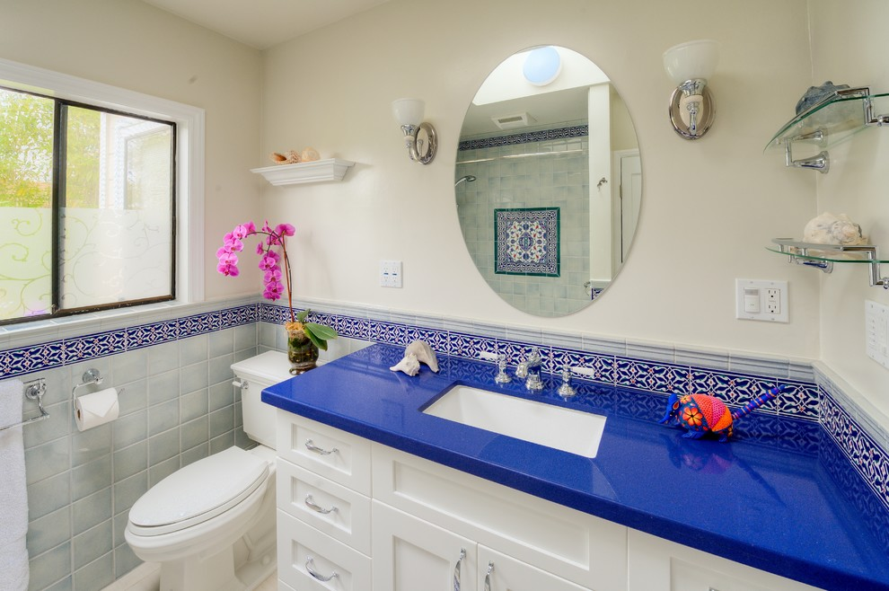 Bathroom - mid-sized mediterranean 3/4 blue tile, red tile, white tile and ceramic tile ceramic tile and multicolored floor bathroom idea in Los Angeles with an undermount sink, shaker cabinets, white cabinets, white walls, quartz countertops, a hinged shower door, a two-piece toilet and blue countertops