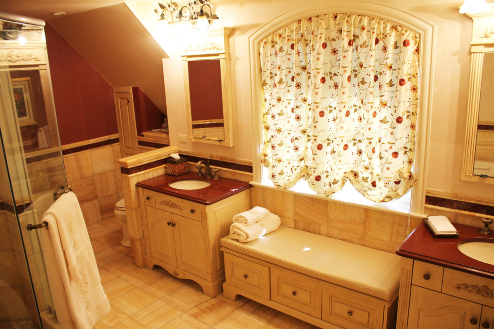 Example of a large tuscan master stone tile porcelain tile alcove bathtub design in New York with shaker cabinets, a two-piece toilet and beige walls