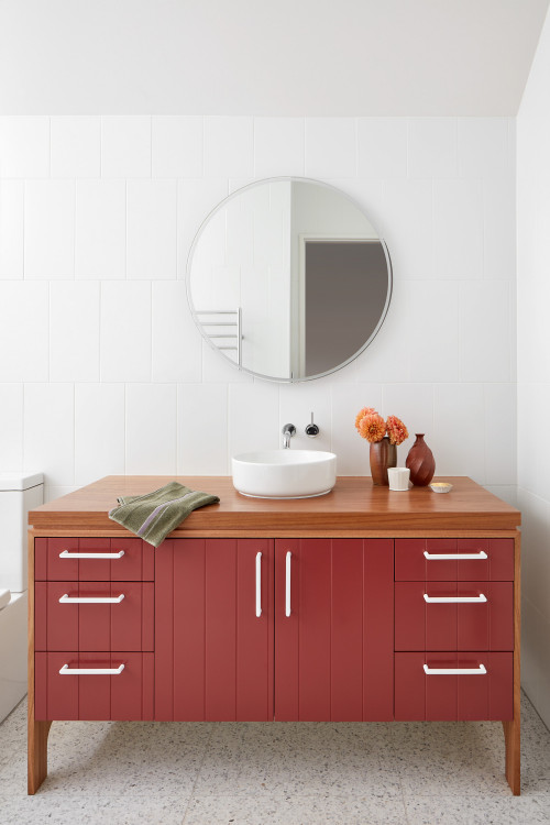 terracotta red vanity in white bathroom