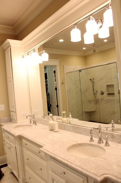 Inspiration for a master white tile ceramic floor bathroom remodel in Miami with an undermount sink, raised-panel cabinets, white cabinets, marble countertops, a one-piece toilet and beige walls