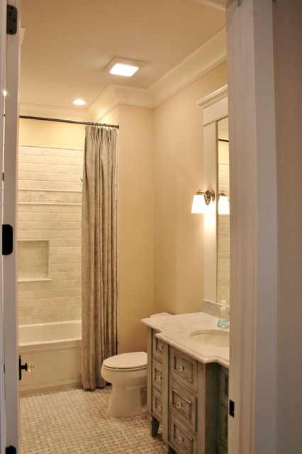 Kids' white tile ceramic floor bathroom photo in Miami with an undermount sink, furniture-like cabinets, distressed cabinets, marble countertops, a one-piece toilet and beige walls