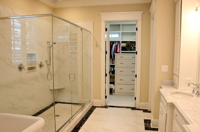 Bathroom - master white tile ceramic floor bathroom idea in Other with an undermount sink, raised-panel cabinets, white cabinets, marble countertops, a one-piece toilet and beige walls