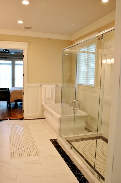 Master white tile ceramic floor bathroom photo in Miami with an undermount sink, raised-panel cabinets, white cabinets, marble countertops, a one-piece toilet and beige walls