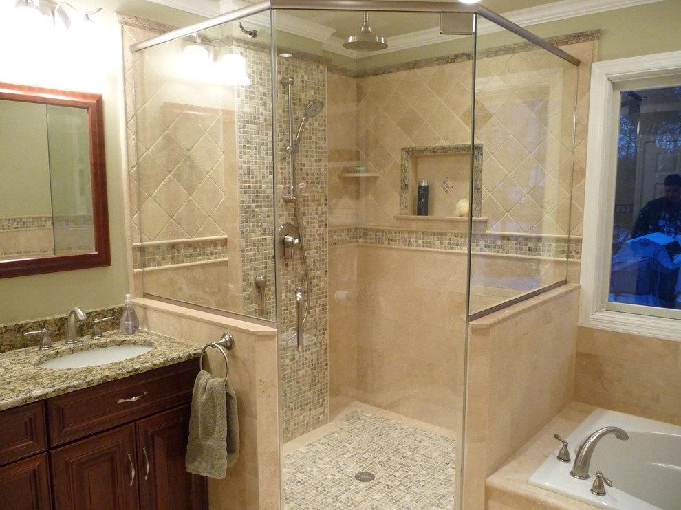 Inspiration for a timeless travertine tile drop-in bathtub remodel in Philadelphia