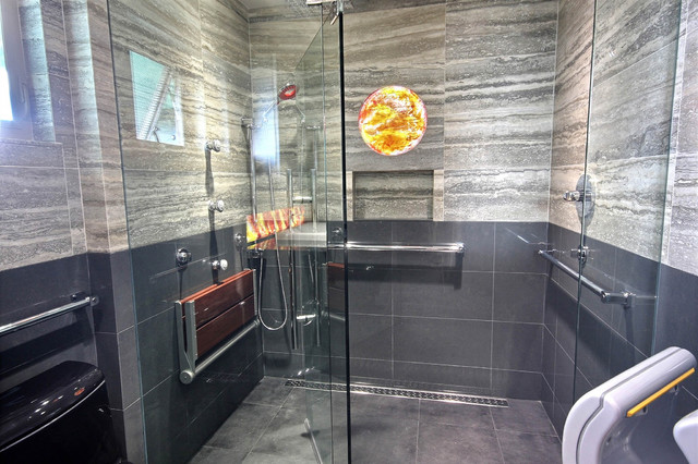 Universal design with wall mounted sinks and Roman, roll-in showers