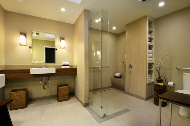Inspiration for a large contemporary master porcelain floor and beige floor bathroom remodel in Austin with a trough sink, wood countertops, a one-piece toilet, beige walls and open cabinets