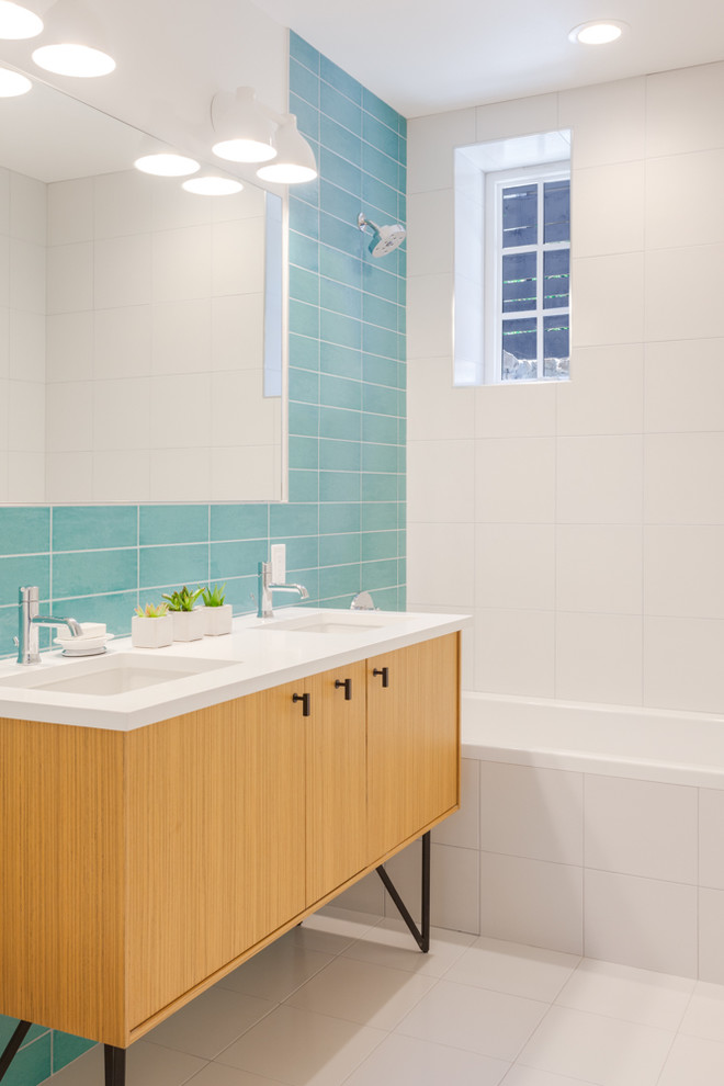 Inspiration for a small contemporary kids' blue tile and ceramic tile ceramic tile and white floor bathroom remodel in Denver with flat-panel cabinets, light wood cabinets, a one-piece toilet, white walls, an undermount sink and quartz countertops