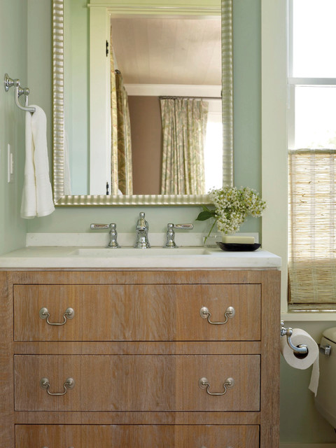 Example of a transitional bathroom design in Charleston with an integrated sink and green walls