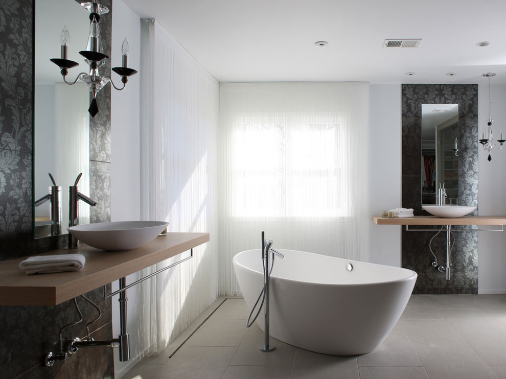 Example of a minimalist freestanding bathtub design in DC Metro with a vessel sink