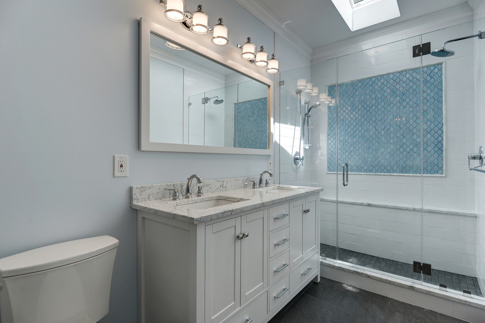 Inspiration for a mid-sized contemporary master black and white tile and ceramic tile porcelain tile bathroom remodel in DC Metro with beaded inset cabinets, white cabinets, a two-piece toilet, blue walls, an undermount sink and marble countertops