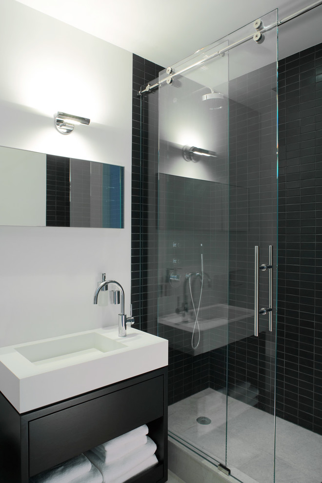 Inspiration for a contemporary black tile and ceramic tile alcove shower remodel in New York with open cabinets, an integrated sink and black cabinets