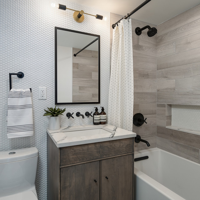 Example of a mid-sized transitional 3/4 gray tile, white tile and mosaic tile bathroom design in New York with flat-panel cabinets, dark wood cabinets, a one-piece toilet, an undermount sink and white countertops