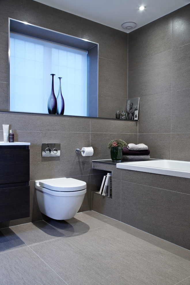 Example of a trendy bathroom design in London with a wall-mount toilet