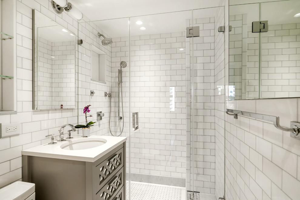 Small elegant master white tile and subway tile mosaic tile floor alcove shower photo in New York with furniture-like cabinets, gray cabinets, white walls, an undermount sink and quartz countertops