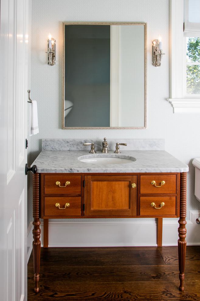 Elegant dark wood floor bathroom photo in Philadelphia with furniture-like cabinets, medium tone wood cabinets, white walls and an undermount sink