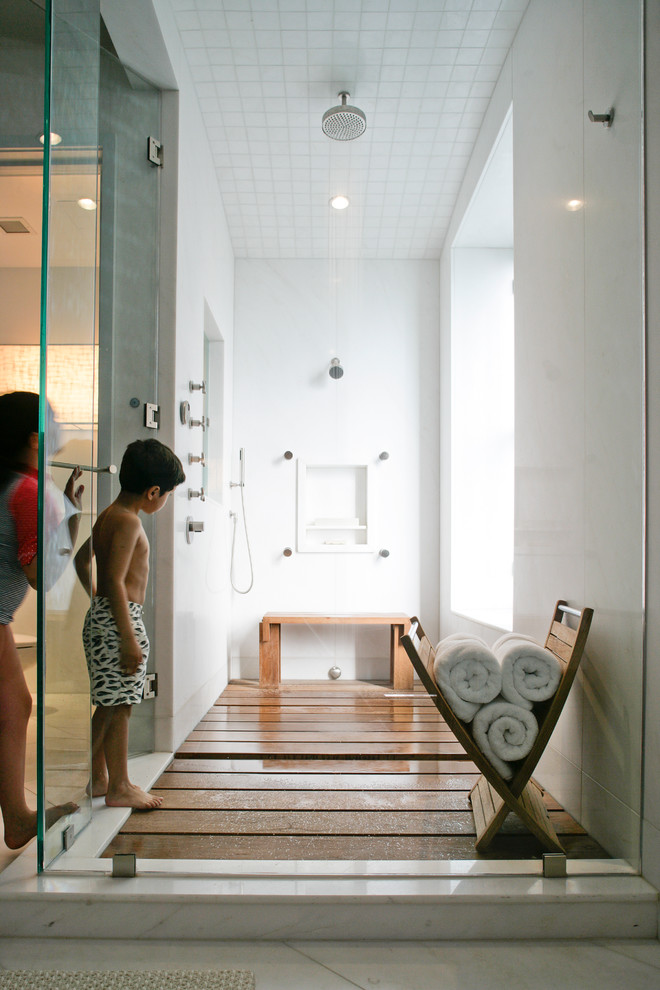 Inspiration for a mid-sized contemporary 3/4 medium tone wood floor doorless shower remodel in New York with a hinged shower door and white walls