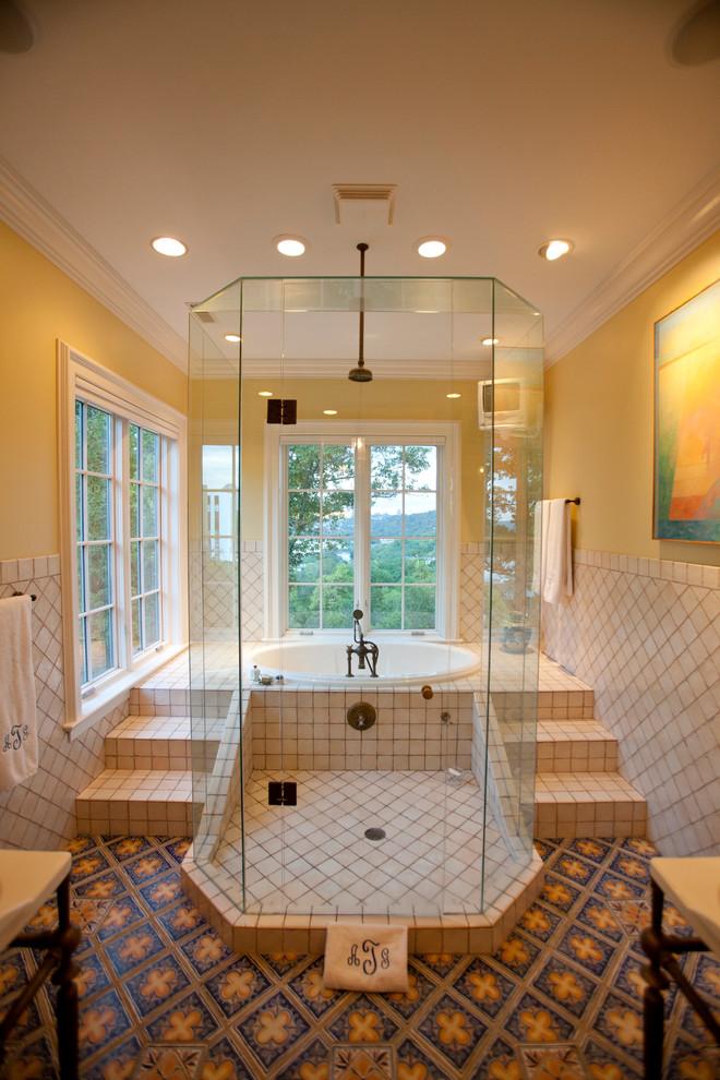 Inspiration for a timeless beige tile drop-in bathtub remodel in Cincinnati